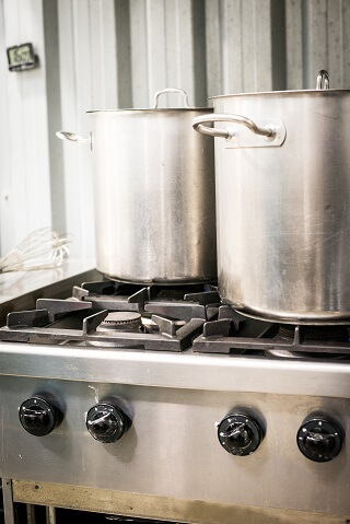 two large cooking pots on the gas stove for making authentic seitan